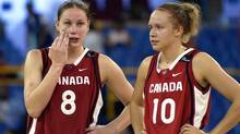 Canada's Kim Smith, left, and Shona Thornburn talk with seconds left in their game against Brazil in women's basketball at the 2003 Pan American Games, Saturday, Aug. 9, 2003, in Santo Domingo, Dominican Republic. (Mark J. Terrill/AP)