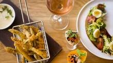 A few of the appetizers at the Left Bank, a new West-End Vancouver restaurant, including heirloom tomatoes with caramelized bocconcini, spicy albacore tuna cone and tempura hairicot (green beens) frites. (John Lehmann/The Globe and Mail)