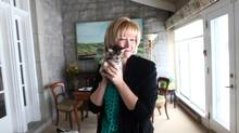 Laureen Harper holds up one of her adopted kitten on March 6, 2013, at 24 Sussex, the official residence of the Prime Minister in Ottawa. (Dave Chan for The Globe and Mail)