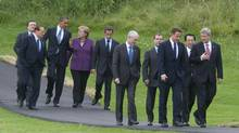 In this photo provided by the G8/G20 Summit G-8 leaders walk down a path to pose for a leaders' group photo at the on June 25, 2010 in Huntsville, Ontario, Canada. (Pawel Dwulit/Getty Images)