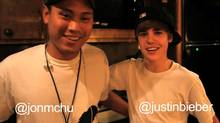 Jon Chu and Justin Bieber in the YouTube video announcing that Chu will direct the upcoming movie about the singing sensation.