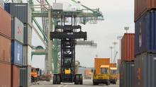 Merchandise trade posted a small $400-million deficit after five months of surplus. That's a reversal from a revised surplus of $200-million in March. (Sandor Fizli/The Globe and Mail)