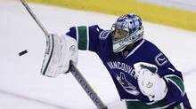 Vancouver Canucks goalie Roberto Luongo makes a save in game one against the The L.A. Kings during NHL playoff action in Vancouver April 11, 2012. (John Lehmann/The Globe and Mail)