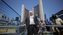 Toronto Mayor Rob Ford took the unusual step of wearing his chain of office, usually reserved for formal occasions such as Remembrance Day, to two events on Friday. (Chris Young/The Canadian Press)