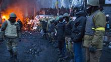 Protesters prepare for another night of watching over their makeshift barricade in Kiev on Jan. 28, 2014. (JOHN LEHMANN/THE GLOBE AND MAIL)