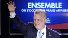 Quebec Liberal leader Philippe Couillard takes the stage after winning the provincial election Monday April 7, 2014 in St-Felicien, Que. (Jacques Boissinot/THE CANADIAN PRESS)