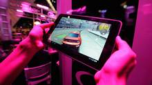 An exhibitor plays a video on the T-Mobile LG G-Slate tablet at the T-Mobile booth during the Electronic Entertainment Expo on June 7, 2011 in Los Angeles. (Kevork Djansezian/Getty Images)