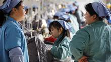 Workers are seen at a textile factory in Huaibei, in east China's Anhui province, on Nov. 21, 2011. China's manufacturing activity slumped to its lowest level in 32 months in November, banking giant HSBC said, renewing fears the Asian powerhouse is losing steam amid global economic woes. (AFP/Getty Images/AFP/Getty Images)