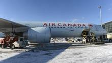 An Air Canada jet sits at a gate in Toronto. (Fred Lum/The Globe and Mail)