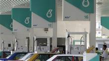 Motorists pump natural gas at a Petronas station in Kuala Lumpur. By far the largest shareholder in Progress Energy Resources Corp. is the Canada Pension Plan Investment Board, which own 37.5 million shares - so this deal costs the CPP $375-million. (BAZUKI MUHAMMAD/REUTERS)