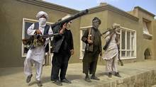 Taliban fighters pose with weapons at an undisclosed location in southern Afghanistan in this May 5, 2011 picture. (STRINGER/AFGHANISTAN/Reuters)