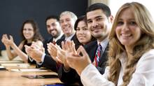 Business group clapping. (iStockphoto)