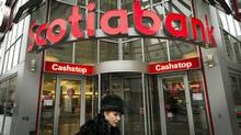 Pedestrians pass by the Scotiabank location near Yonge and Bloor Streets in Toronto. (Kevin Van Paassen/The Globe and Mail)