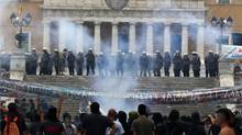 Riot police protects the parliament during violent protests in Athens' Syntagma square, June 29, 2011. Greece's parliament has approved unpopular austerity measures on Wednesday, despite violent protests, to secure international funds to prevent the euro zone's first sovereign default. (YANNIS BEHRAKIS/REUTERS/YANNIS BEHRAKIS/REUTERS)