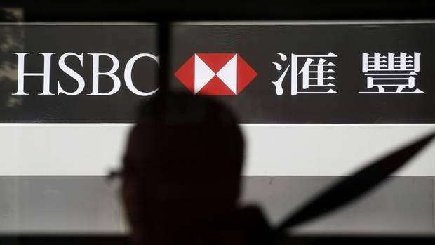 Man walks past the hsbc s hong kong headquarters in central district