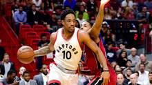 Toronto Raptors guard DeMar DeRozan is guarded by Miami Heat's Rodney McGruder in Miami on March 11, 2017. (Steve Mitchell/USA Today Sports)
