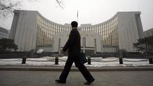 China's central bank building in Beijing. As part of Beijing's overhaul of the finances of heavily-indebted local governments, the central government will pay off some of their loans (STRINGER/CHINA/REUTERS)