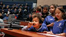 Six-year-old Ibrahim Aden, player with Ifyes soccer club in Etobicoke, takes his turn to talk while attending, along with his team, a public meeting a Toronto City Hall to discuss the impact of new user fees the city is imposing for city owned sport fields. (Fernando Morales/Fernando Morales/The Globe and Mail)