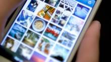 Instagram is used on an iPhone Monday, April 9, 2012, in New York. (Karly Domb Sadof/AP)
