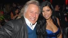 Peter Nygard is seen with with model Suelyn Medeiros at a 2007 gala. (Janice Pinto for The Globe and Mail)