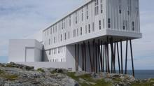 The steel legs of Fogo Island Inn echo the wooden struts beneath traditional fishing stages. (CATHERINE BUSH)