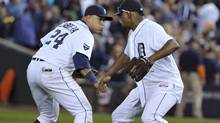 Detroit Tigers first baseman Miguel Cabrera (L) and pitcher Jose Valverde celebrate after the Tigers defeated the Texas Rangers in Game 3 of the MLB American League Championship Series baseball playoffs in Detroit, October 11, 2011. (MIKE CASSESE/REUTERS)