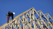 A new home under construction in Richmond Hill, Ont., is seen in this file photo. CMHC said housing starts slipped in June but the overall trend remains stable (Moe Doiron/Moe Doiron/The Globe and Mail)