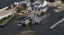 Keeping a six-month supply of cash to pay expenses in the event of a natural disaster like Hurricane Sandy should be part of every family's financial plan. (Reuters)