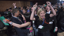 Delegates Michelle Rebel and Natalie Pon celebrate the yes vote to change the wording of the traditional definition of marriage in the conservative policies at the Conservative Party of Canada convention in Vancouver, Saturday, May 28, 2016. (Jonathan Hayward/THE CANADIAN PRESS)