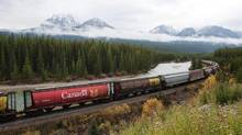 Rail cars loaded with canadian wheat travel through the Rocky Mountains on the Canadian Pacific railway line near Banff, Alberta, October 6, 2011. Share prices for Canadian Pacific Railway Ltd. and Canadian National Railway Co. have fallen by 8 per cent and 7 per cent, respectively, over the past five trading days as investors weighed the prospect that rail companies would see a decline in oil volumes as producers either scale back production or balk at paying the $15 to $20 premium to ship a barrel of oil by rail. (Todd Korol/Reuters)
