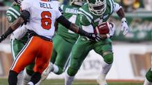 Saskatchewan Roughriders running back Kory Sheets (1) runs the ball past BC Lions corner back Joshua Bell (6) during the first half of their west semi-final CFL football game in Regina, Saskatchewan November 10, 2013. (REUTERS)