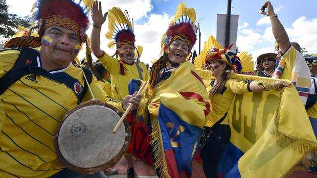 Colombian fans dance outside Mineirao Stadium before the group C World Cup soccer match between Colombia and Greece in Belo Horizonte, Brazil, Saturday, June 14, 2014. (Martin Meissner/AP)