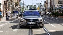 A Mercedes-Benz S 500 Intelligent Drive rides autonomously through country roads and inner-city traffic. (Mercedes-Benz)