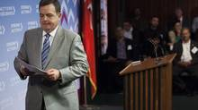 Finance Minister Dwight Duncan leaves a press conference at Queen's Park Wednesday. (Michelle Siu/THE CANADIAN PRESS)