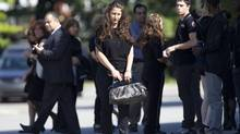 Mourners arrive for the funeral of 18-year old Sammy Yatim Aug 1, 2013. Yatim was shot dead by police during a standoff early Saturday in Toronto. (Moe Doiron/The Globe and Mail)
