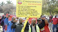 Oil workers are demanding double-digit wage hikes in South Africa. STEPHANE DE SAKUTIN/AFP/Getty Images (STEPHANE DE SAKUTIN/AFP/Getty Images)