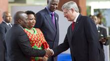 Prime Minister Stephen Harper is greeted by Democratic Republic of Congo President Joseph Kabila and his wife Olive as Secretary General of La Francophonie Abdou Diouf looks on at the Francophonie Summit in Kinshasa, Democratic Republic of Congo, Saturday, October 13, 2012. (Paul Chiasson/THE CANADIAN PRESS)