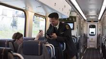 A passenger has her ticket scanned on the new Union Pearson Express airport rail link in Toronto on Saturday, June 6, 2015. THE CANADIAN PRESS/Michelle Siu (Michelle Siu/The Canadian Press)
