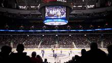 Fans watch as the puck drops during he Vancouver Canucks season home opener against the Pittsburgh Penguins at Rogers Arena in Vancouver, British Columbia, Thursday, October 6, 2011. (Rafal Gerszak For The Globe and Mail)