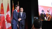Canadian Prime Minister Justin Trudeau and China Premier Li Keqiang embrace on Sept. 23, 2016 at a conference of the Canada China Business Council in Montreal. (Clement Sabourin/AFP/Getty Images)