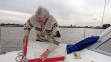 Fiona McCall takes down the sails before superstorm Sandy hits. (Paul Howard)