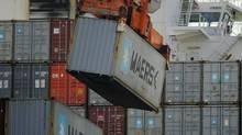 A ship-to-shore crane unloads a shipping container at the Georgia Ports Authority Garden City terminal in Savannah, Ga. (STEPHEN B. MORTON/AP)
