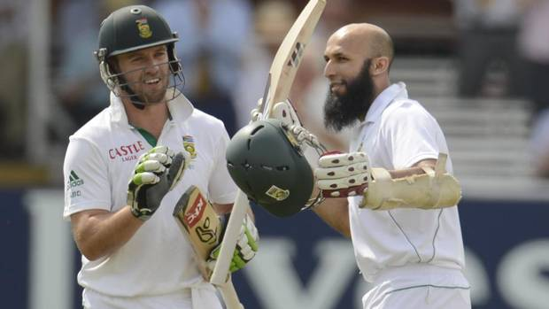South Africa's Hashim Amla celebrates reaching his century as he is watched by teammate AB de Villiers (L) during the third cricket test match at Lord's in London August 19, 2012. (PHILIP BROWN/REUTERS)