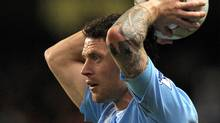 Manchester City's English defender Wayne Bridge takes a throw-in during the FA Cup fifth round football match between Manchester City and Stoke City at The City of Manchester Stadium, Manchester, north-west England on February 13, 2010. (ANDREW YATES)