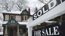 A realtor's 'Sold' sign stands outside this home in Toronto's desirable beach neighbourhood in this file photo. (Fred Lum/Fred Lum/The Globe and Mail)