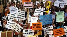 Wits University students and lecturers hold placards as they take part in a public march to protest the cancellation of the Dalai Lama's visit to South Africa, in Johannesberg October 5, 2011. (SIPHIWE SIBEKO/REUTERS)