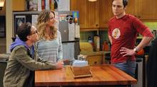 "This image released by CBS shows, from left, Johnny Galecki, Kaley Cuoco and Jim Parsons in a scene from ""The Big Bang Theory."" = (MICHAEL YARISH/AP)"
