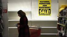Customers shopping at a Target store in Toronto. Target Canada, which filed for creditors' court protection in January and closed all 133 stores, has so far raised roughly $900-million from selling off properties and inventory. (Fred Lum/The Globe and Mail)