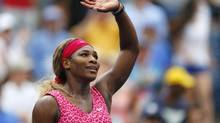 Serena Williams, of the United States, waves to the crowd after defeating Varvara Lepchenko, of the United States, during the third round of the 2014 U.S. Open tennis tournament, Saturday, Aug. 30, 2014, in New York. (Matt Rourke/AP)