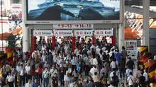 Visitors walk through an entrance to China Import and Export Fair, also known as the Canton Fair, in the southern Chinese city of Guangzhou October 17, 2011. Exporters at China's largest trade show, the Canton Fair, say a darkening economic outlook in Europe and the United States is weighing on orders for Chinese-made goods from Western buyers, potentially boding ill for China's growth prospects. (BOBBY YIP/BOBBY YIP/REUTERS)